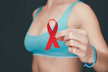 woman with red aids ribbon