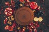 empty plate among fruits