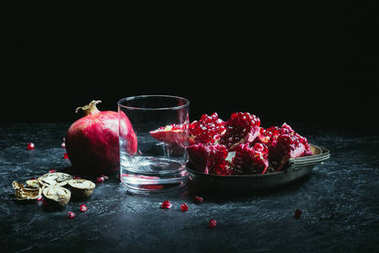 Empty glass and pomegranates