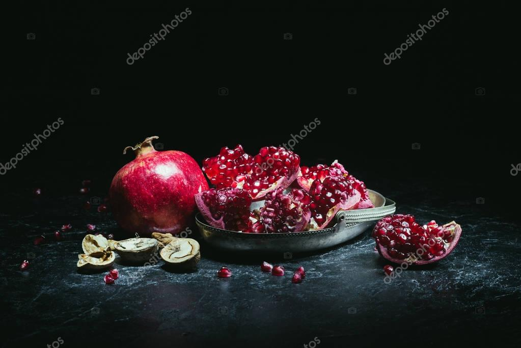 pomegranates in metal bowl