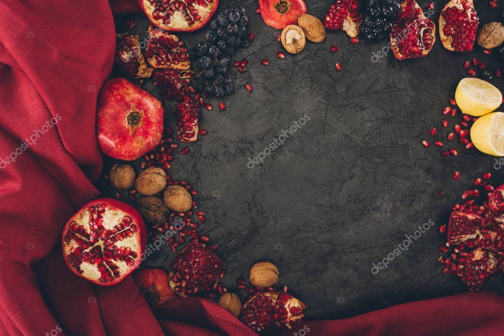 fruits with walnuts and red fabric