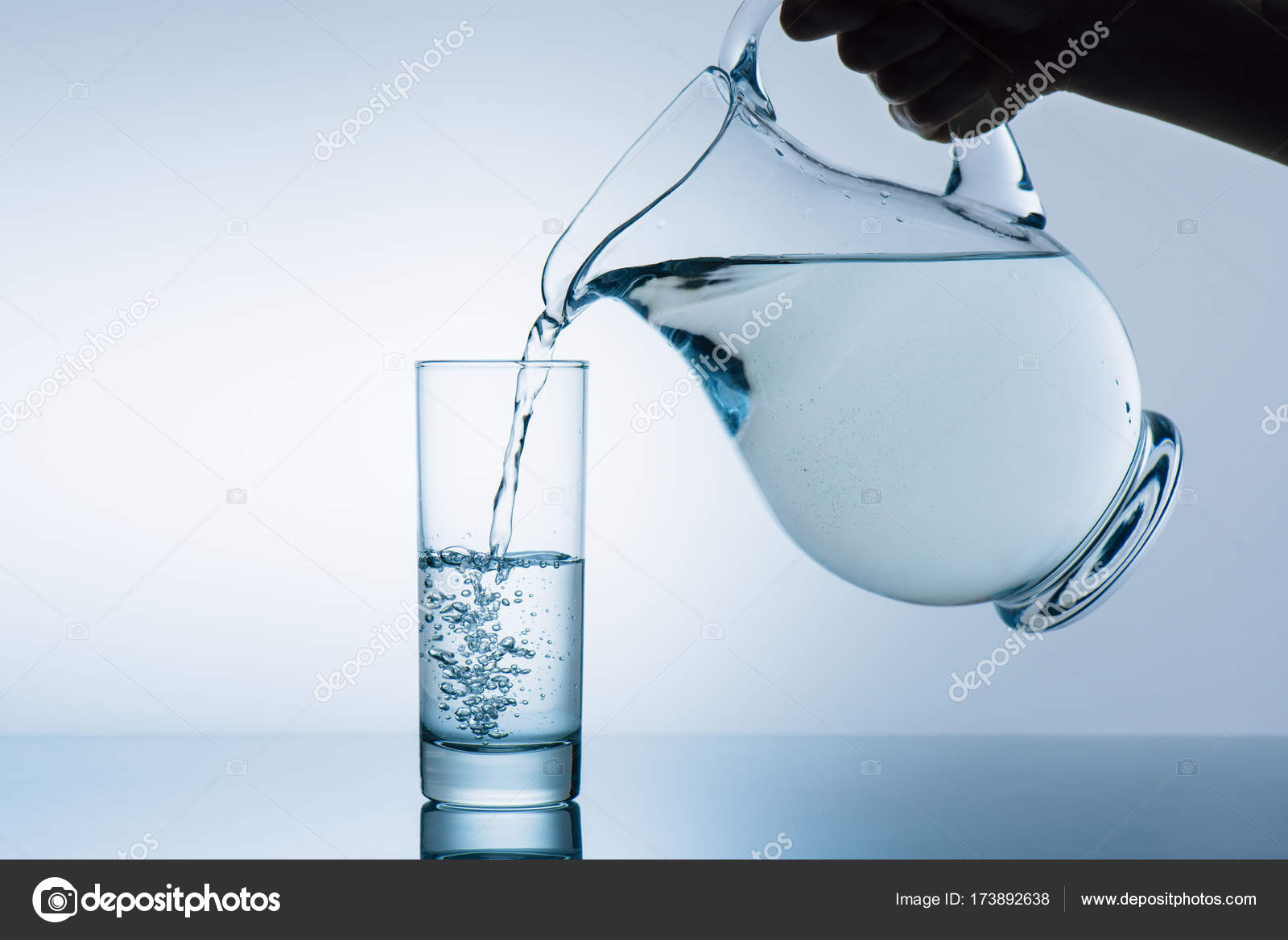 woman pouring water from jug stock photo vadimvasenin 173892638