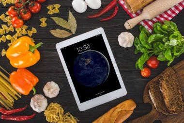 digital tablet and fresh ingredients