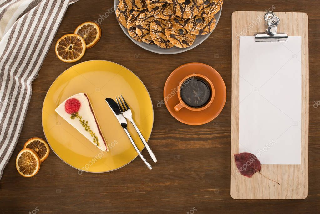 sheet of paper on clipboard and dessert
