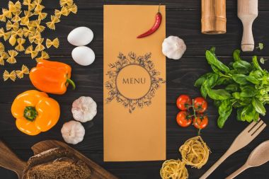 Top view of restaurant menu and fresh raw ingredients on wooden table stock vector