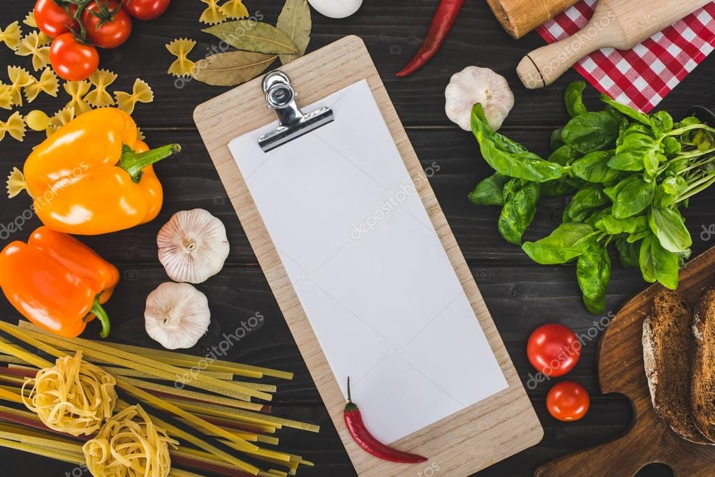 sheet of paper on clipboard and ingredients