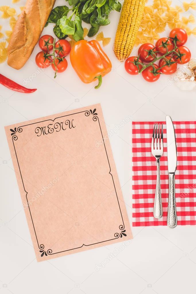 menu, cutlery and ingredients
