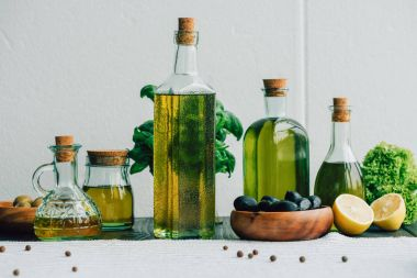 olive oil bottles with vegetables