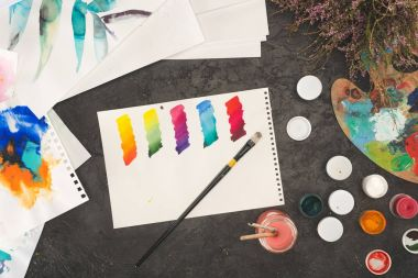 Top view of sketch of mixed watercolor paints on painter working table stock vector
