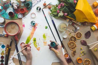 designer holding brush and poster paint