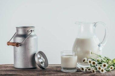 fresh milk in jugs with flowers