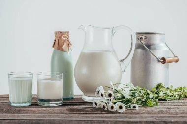 jugs, bottle and glasses of fresh milk
