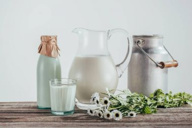 jugs, bottle and glass of milk