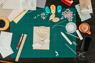 Top view of handmade scrapbooking postcard on a table