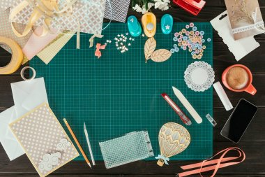 Top view of table with elements for scrapbooking postcard