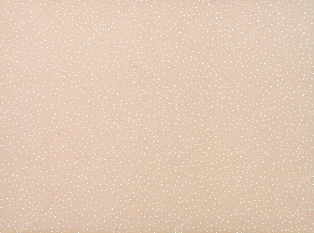 set of different sized white circles on beige