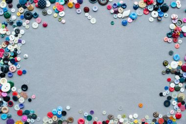Top view of colorful buttons frame on grey cloth background stock vector