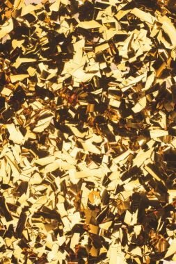 close up view of sparking golden confetti