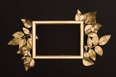 Top view of golden photo frame and leaves isolated on black stock vector