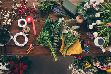 top view of parts of bouquet and decoration tools on table