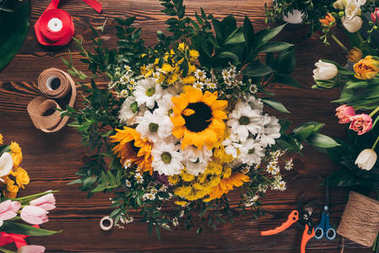 top view of bouquet of flowers on wooden table