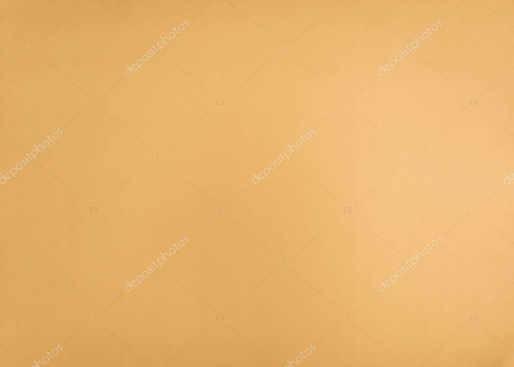 full frame of bright orange wallpaper texture as a background