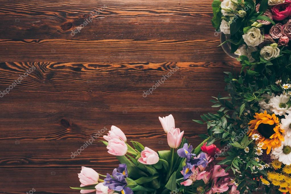 top view of tulips and roses on table in flower shop