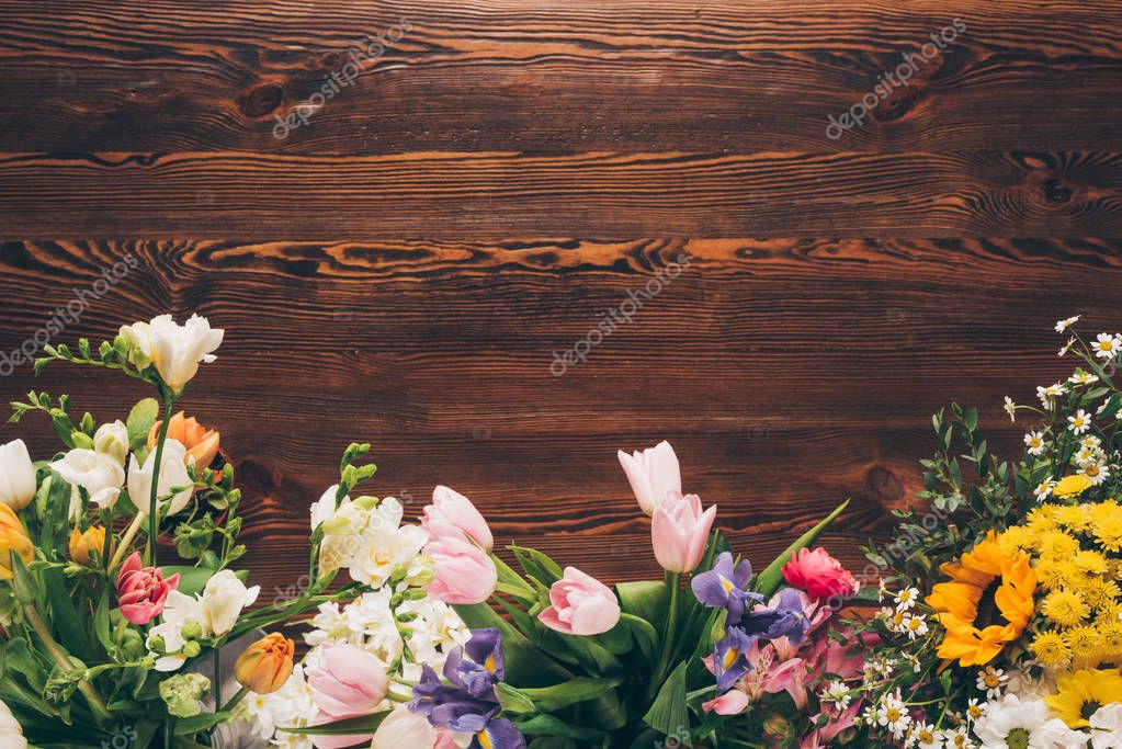 top view of different colored flowers on table in flower shop
