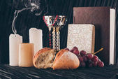 grapes, bread, holy bible, christian cross and chalice for Holy Communion