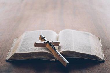 Christian cross on open holy bible stock vector