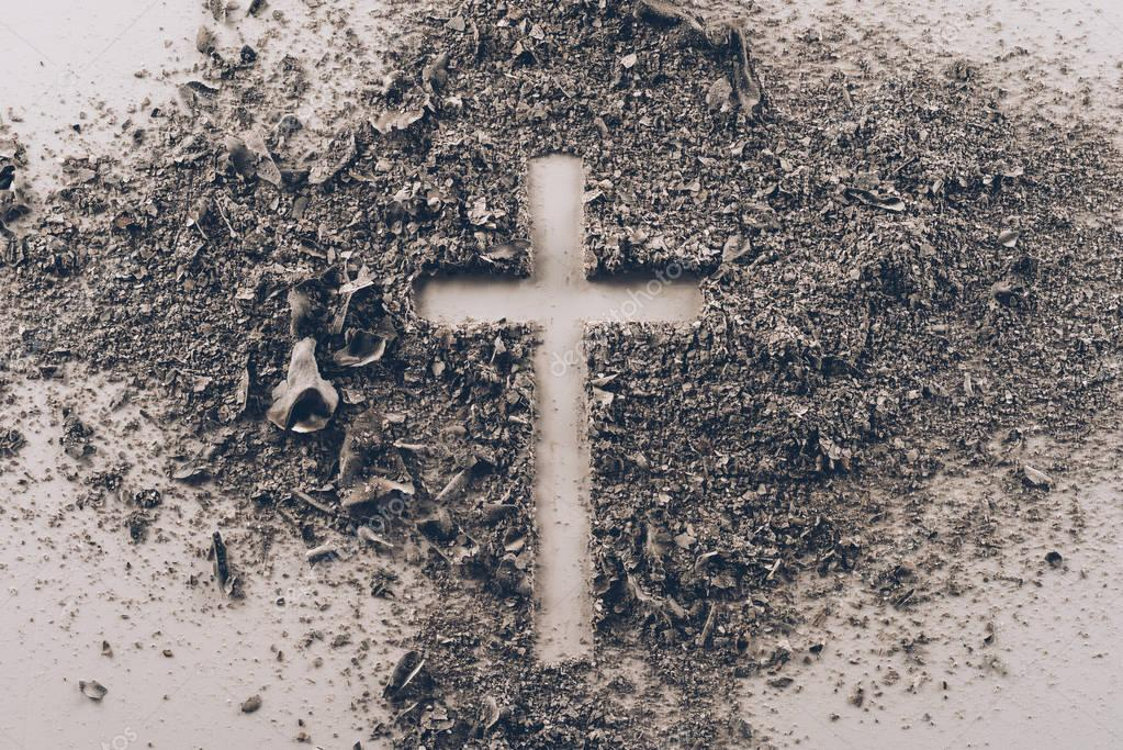 top view of cross shape from ash on white table