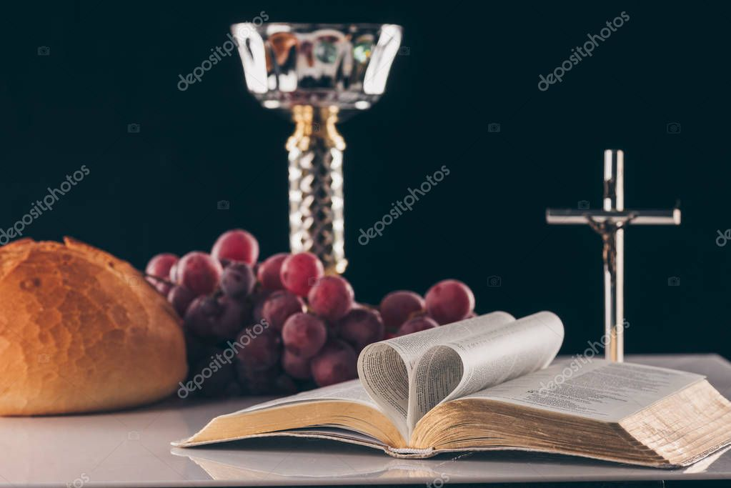 Open holy bible, christian cross and chalice on table, Holy Communion stock vector