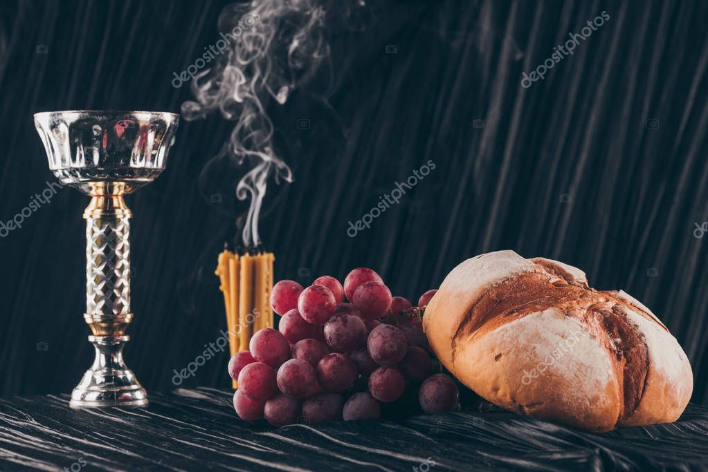 Bread, grapes, candles and chalice on dark fabric for Holy Communion stock vector