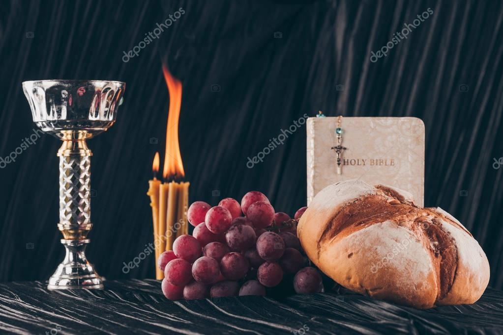 Holy bible, surface and christian cross with candles on dark table for Holy Communion stock vector