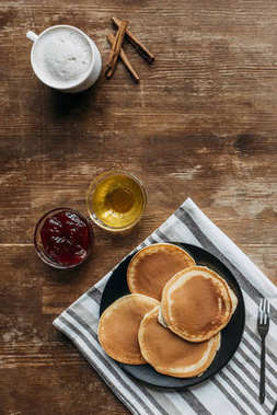 top view of pancakes with coffee cup on wooden table