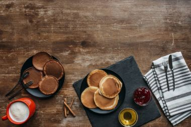 top view of tasty breakfast with pancakes and coffee on wooden table