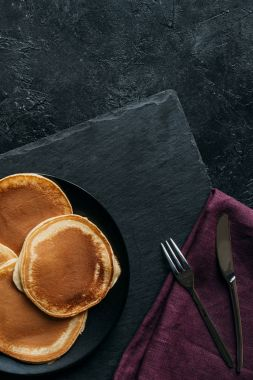 top view of freshly baked pancakes on black surface