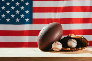 american flag and sport equipment on foreground