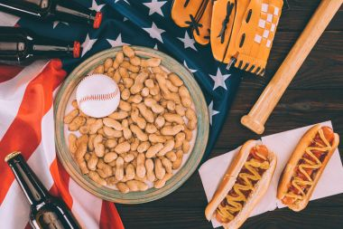 top view of various snacks and sport equipment with us flag on wooden table