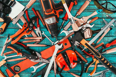 Flat lay with various carpentry equipment on blue wooden surface stock vector