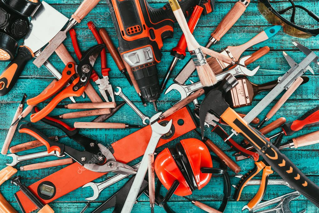 flat lay with various carpentry equipment on blue wooden surface