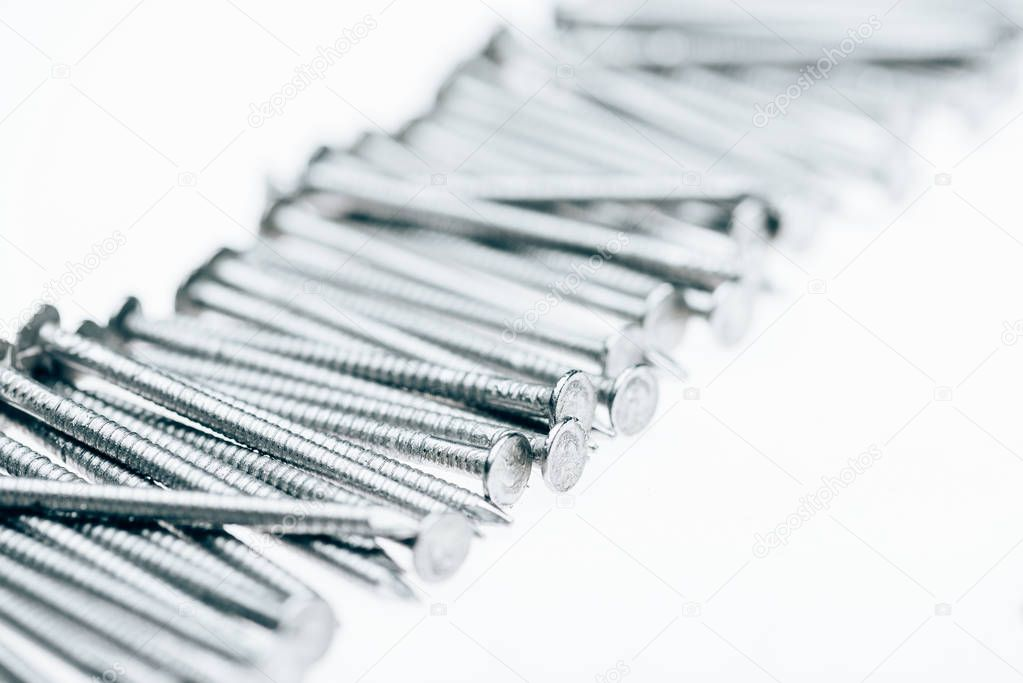 close up view of metal framing nails isolated on white