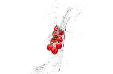 Fresh cherry tomatoes in water splashes isolated on white stock vector