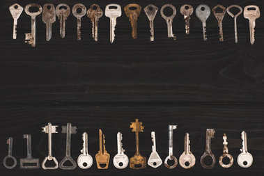 top view of vintage keys frame on black table