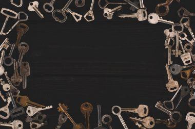 top view of vintage keys frame on black table
