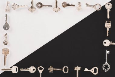 top view of different vintage keys frame over black and white background