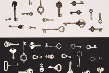 Top view of different vintage keys over black and white background stock vector