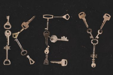 top view of metal keys forming word on black table