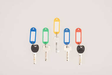 top view of set different keys with colorful labels isolated on white
