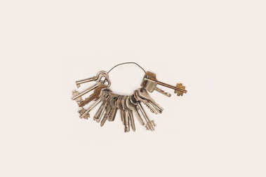 top view bunch of vintage keys isolated on white